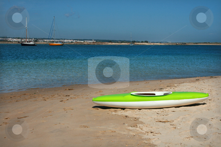 Lost boat stock photo, Green boat on a beach coast and two more boats by Marc Torrell