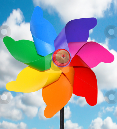 Windmill stock photo, Corlorful windmill toy on a blue sky by Marc Torrell