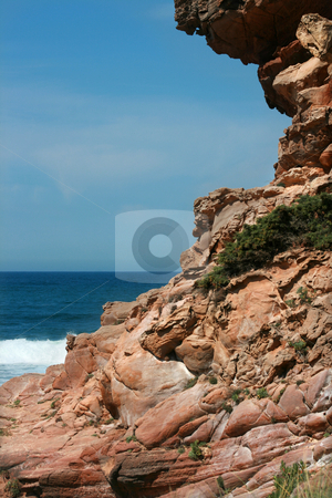 Red coast stock photo, Red rocks on the coast by Marc Torrell