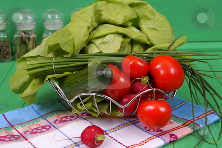 Vegetables stock photo, Spring vegetables lying  by sideon on table by Jolanta Dabrowska