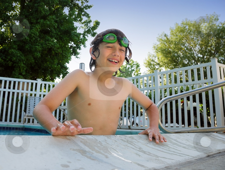 Pool Fun stock photo, Teen boy with swimming goggles having fun at the pool. by Denis Radovanovic