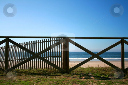 Handrail beach stock photo, Wood handrail of a Mediterranean beach by Marc Torrell