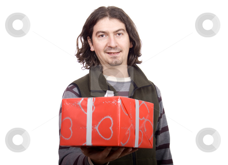 Couple giving a present stock photo, Young man giving a present to a pretty woman by Marc Torrell