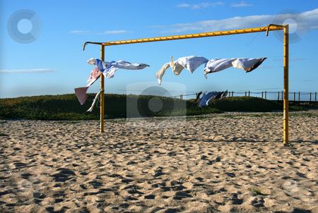 Beach soccer stock photo, Beach soccer yellow goal with dry clothes by Marc Torrell
