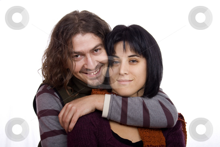 Happy couple stock photo, Hug between a young man and pretty woman couple by Marc Torrell