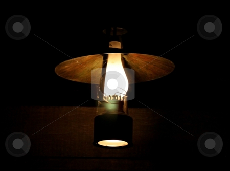West lamp stock photo, Old oil lamp of the far west by Marc Torrell