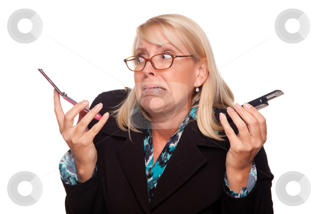 Frustrated Woman with Two Cell Phones stock photo, Frustrated Woman with Two Cell Phones Isolated on a White Background. by Andy Dean