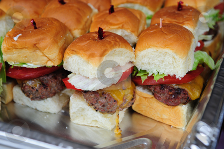 Mini Cheese Burgers stock photo, Little hamburgers with letuce, tomato and cheese ready to serve by Lynn Bendickson