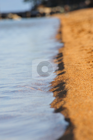 Sand And Water stock photo, Tight focus of an area of a sandy beach on a fresh water lake lake by Lynn Bendickson