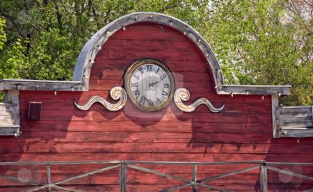 Portion of Old Building With Clock stock photo, This is a portion of an old western styled building with a clock located in the central area. by Valerie Garner