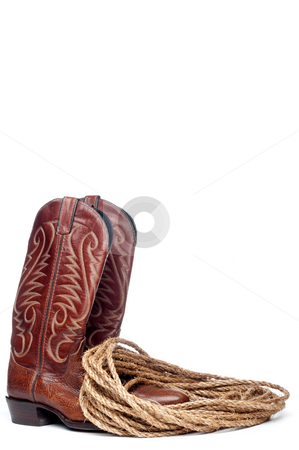A vertical image of a pair of brown cowboy boots and a coil of r stock photo, A vertical image of a pair of brown cowboy boots and a coil of rope on a white background by Vince Clements