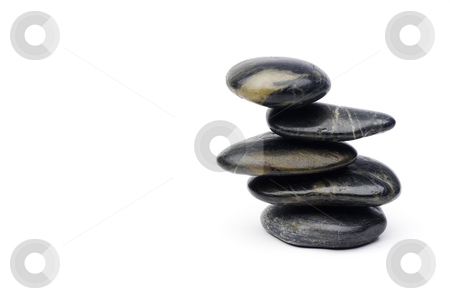 A horizontal image of carefully blanced stacked river rock on wh stock photo, A horizontal image of carefully blanced stacked river rock on white by Vince Clements