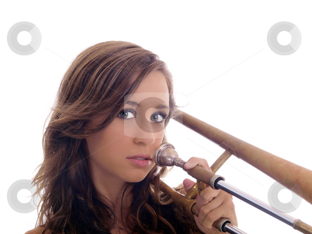 Portrait of young woman holding old trombone stock photo, Young woman portrait holding up old trombone by Jeff Cleveland