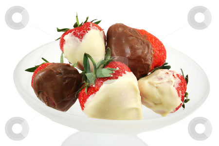 Chocolate Dipped Strawberries Close Up stock photo, Milk and white chocolate dipped fresh strawberries in a frosted glass dish by Helen Shorey