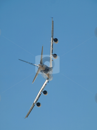 Jumbo airliner stock photo, Rear profile of an aircraft  flying in blue sky by Laurent Dambies