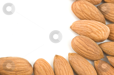 Almonds border. stock photo, Almond nuts forming a frame, in white background. by Pablo Caridad