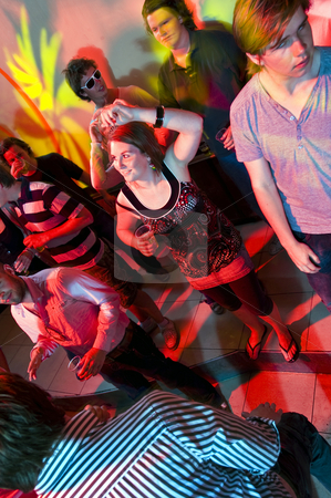 Dancing stock photo, Dancing people in a nightclub with various light effects and motion by Corepics VOF
