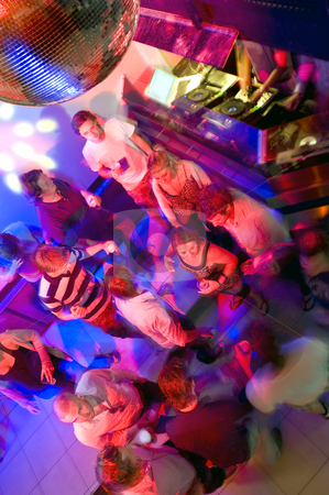 Dancing people stock photo, Busy dancefloor in a nightclub near the DJ booth by Corepics VOF