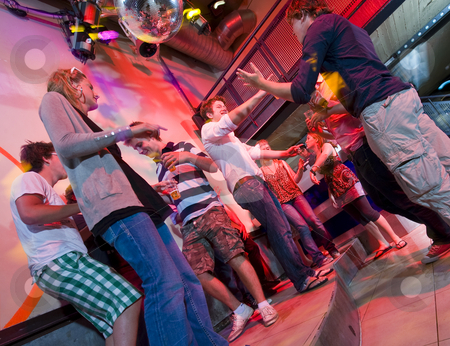 Dancing people stock photo, Group of people dancing in a trendy nightclub by Corepics VOF