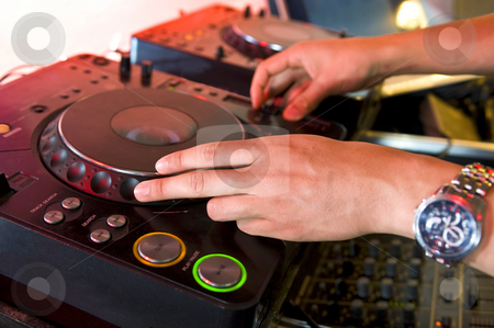 Dee Jay  stock photo, The hands of a dj on a turntable in a club by Corepics VOF