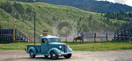 Cowboy's Old Truck stock photo, This shot shows a small town authentic rodeo complete with a cowboy's old truck. by Valerie Garner