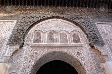 Marrakesh Ben Youssef Medersa stock photo, The Ben Youssef Medersa, an Islamic school attached to the Ben Youssef Mosquein in Marrakesh, arch detail by Roberto Marinello