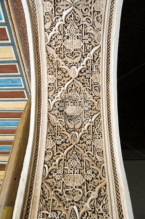 Moorish style stucco background stock photo, A detail of a Moorish style stucco of a arch in Marrakesh by Roberto Marinello