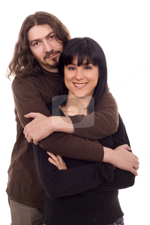Young couple stock photo, Young casual couple hug white isolate by Marc Torrell