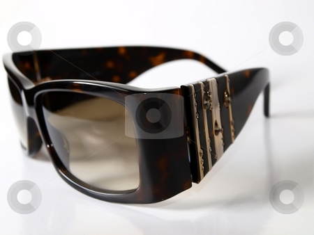Sunglasses stock photo, Luxury shades placed on a white background by Arve Bettum