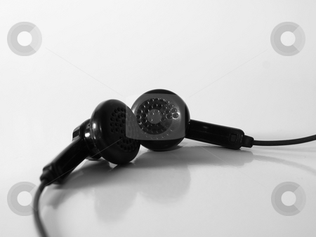 Ear plugs stock photo, Black ear plugs for sound, with wire by Arve Bettum