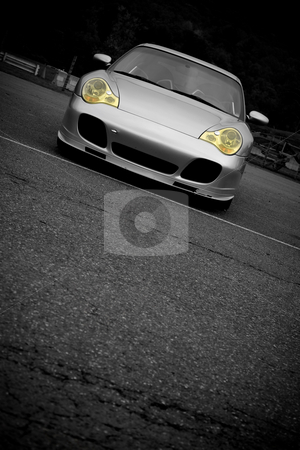 Sports Car With Copyspace stock photo, A silver sports car with the yellow headlights highlighted in selective color.  Plenty of copyspace for your text. by Todd Arena