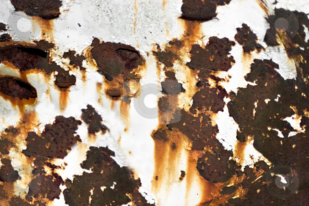 Old Rusted Metal stock photo, Closeup of rusted metal with chipped paint and holes. by Todd Arena