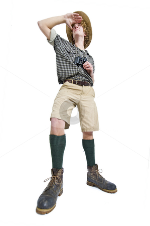 Jungle Man stock photo, A man in jungle outfit with checkered shirt, khakis, knee socks, and binoculars  searching by Corepics VOF