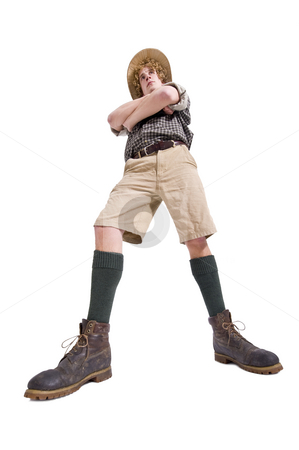 Dauntless Boyscout stock photo, A dauntless boyscout, dressed in joungle outfit with his arms crossed by Corepics VOF