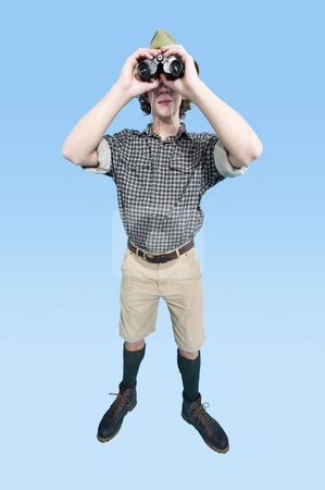 Jungle Man stock photo, A man in jungle outfit with checkered shirt looking through his binoculars by Corepics VOF