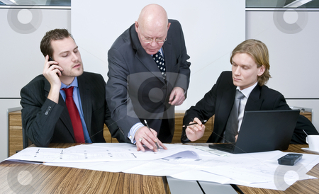 Interfering boss stock photo, Two colleagues in a meeting on an architectural design with an interfering boss behind them by Corepics VOF