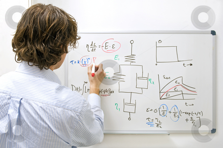 Engineer at whiteboard stock photo, An engineer drawing a complexe physics equation on a whiteboard by Corepics VOF