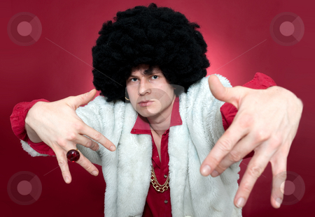 Pimp stock photo, Arrogantly looking man, wearing a wig and a golden chain. by Corepics VOF