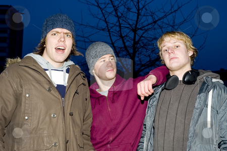 Suburban Portrait stock photo, A portrait of three streetwise men in a suburban environment by Corepics VOF