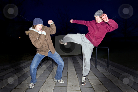 Street fighters stock photo, An aggressive atmosphere in a suburban neighborhood with two men starting a fight by Corepics VOF