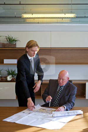 Validating designs stock photo, Young architect asking his boss to validate his designs by Corepics VOF