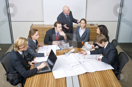 Business team meeting stock photo, A business team going over the design changes at a corporate architectural firm by Corepics VOF
