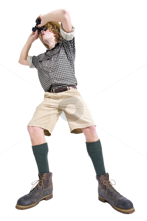 Bird Watcher stock photo, A man in jungle outfit with checkered shirt, khakis, knee socks, and binoculars  searching for rare bird species, with a flabbergasted look on his face by Corepics VOF