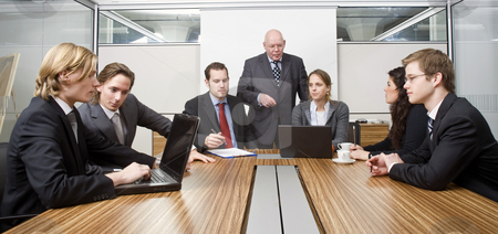 Boardroom meeting stock photo, Seven people in a cubicle, preparing for a management team meeting by Corepics VOF