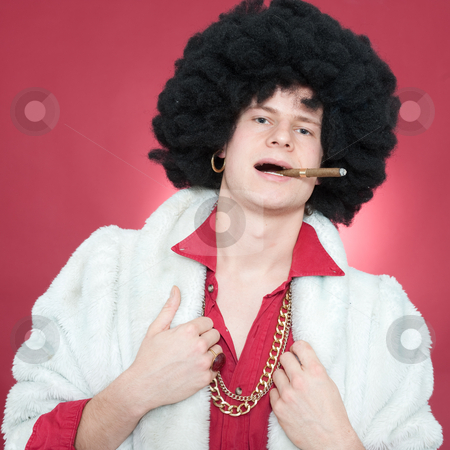 Pimp stock photo, Arrogantly looking man, wearing a wig  and smoking a cigar. by Corepics VOF