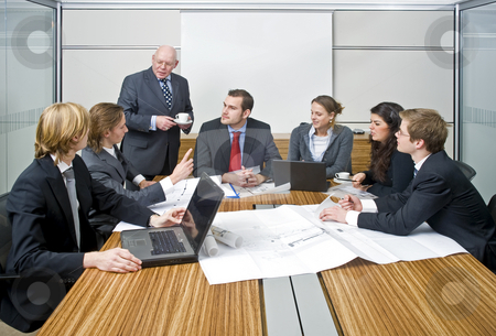 Management Meeting stock photo, A group of six junior associates during a management team meeting with a senior manager by Corepics VOF