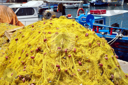 Fishing nets stock photo, Fishing boat and nets. Port of Heraklion, Crete, Greece by Fernando Barozza
