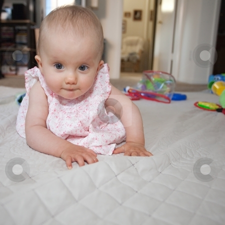 Baby crawling stock photo, Babies usually learn to crawl before they develop walking skills. For humans it usually means moving on knees and hands, with support from the toes. by Mariusz Jurgielewicz