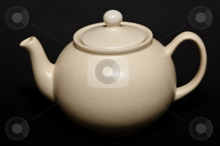 Teapot stock photo, A teapot is a vessel used for steeping tea leaves or an herbal mix in near-boiling water. by Mariusz Jurgielewicz