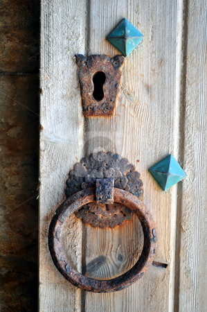Old rusty keyhole and door knocker stock photo, Door knocker at the entrance of the Venetian castle (Koules), in Crete, Greece by Fernando Barozza